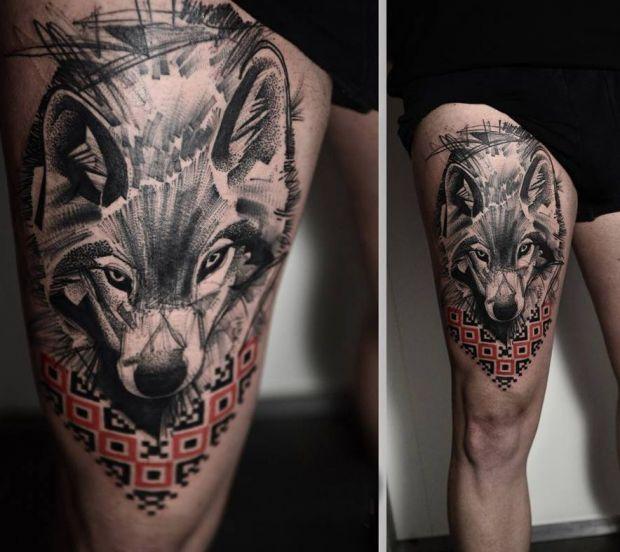 wilki tatuaże na naogę