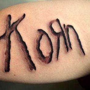 tatuaże napisy korn